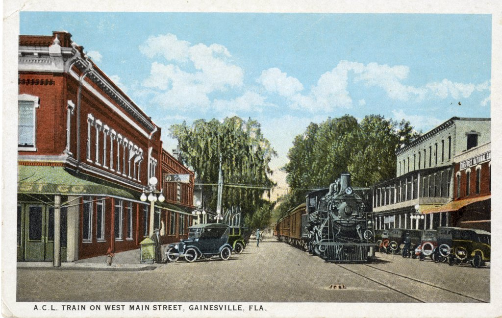A train traveling down Main Street in Gainesville circa 1925